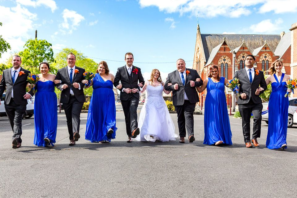 wedding-bridal-party-holding-hands-group-bride-groom-marriage-love-guys-girls-infocus-photography